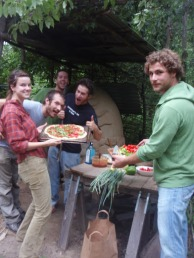 pizza in the earth oven. thumbs up