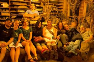 A happy group on the Rocket Stove - Potluck tour 7-2014