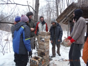Rocket Stove Workshop - constructing a mock-up of the combustion unit.