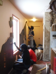 Applying Earth Plaster to the front hall during the Winternship.