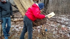 """Lynn using the horizontal reed """"legget"""" to tap up the reed ends into consistent slope and shape."""